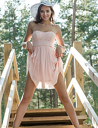 Newcomer Oxana Chic shows off her sexy, tanned body as she strips outdoors.