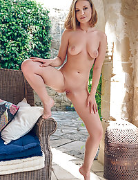 Lucretia K flaunts her smooth cunt as she strips outdoors.