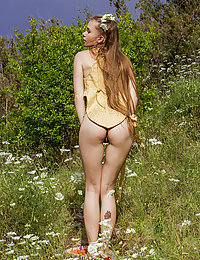 Milena D bares her petite body as she sensually poses in the meadows.