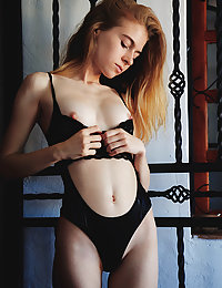 Shayla flaunts her skinny body and tight ass as she strips her black lingerie.
